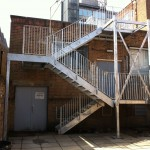 Three flight galvanised steel fire escape staircase