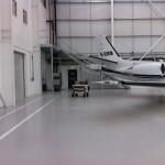 New galvanised steel staircase in airport hangar