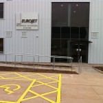 Balustrade up ramp and steps outside airport hangar