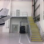 Galvanised steel staircase and landing at airport hangar