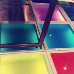 Art flooring with laminated glass