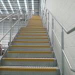 Galvanised steel staircase at airport hangar