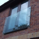 Glass juliette balcony with stainless steel glass adaptors