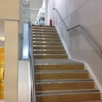 New customer staircase with frameless glass balustrade and stainless steel wall rail