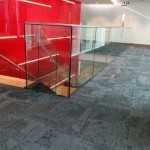 Feature steel staircase with frameless glass balustrade in Birmingham