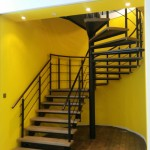 Straight to spiral staircase with running rails and oak timber treads