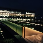 Pedestrian walkway across lake with frameless glass balustrade and LED lighting
