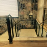 New customer staircase with RHS stringers and mild steel flat uprights, all powder coated, with stainless steel square handrail and toughened glass infill panels
