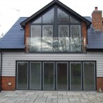 Frameless glass juliette balconies fixed to wall and frame