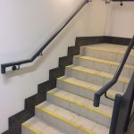 Mild steel balustrade with perforated infill panels to stairs, all powder coated finish