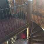 Steel spiral staircase with vertical infill bar balustrade, all mild steel