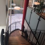 New customer staircase, mild steel powder coated black with vertical infill bar balustrade to stairs and obscured glass to gallery, timber treads and landings, curved mid-landing