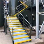 New steel staircase powder coated green with stainless steel handrail