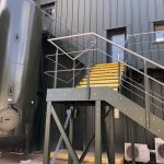Steel staircase powder coated green with stainless steel balustrade