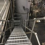 Steel staircase and walkway with open grille flooring