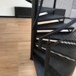 Black steel spiral staircase with checker plate durbar treads and expanded metal balustrade