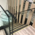 Steel staircase with frameless glass balustrade