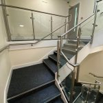 Stainless steel glass balustrade with stainless steel wall rail