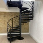 Spiral staircase with checker plate treads powder coated black