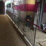 Stainless steel vertical infill bar balustrade with coloured handrail