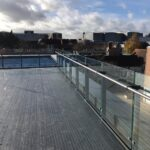 Steel framework terrace with timber decking and stainless steel glass balustrade