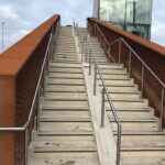 Stainless steel balustrade raking up stairs