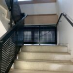 Mild steel perforated infill balustrade and handrail to existing pcc staircase