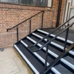 Steel Staircase with black powder coated balustrade and GRP flooring (black with white nosings)