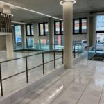 Reception entrance balustrade with top and mid rail, ppc bronze